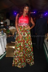 Chika Ike: Worst Dressed Award. I beleieve there are creative styles you could make with Ankara, but all I see here is colour riot and bad masquerade make-up