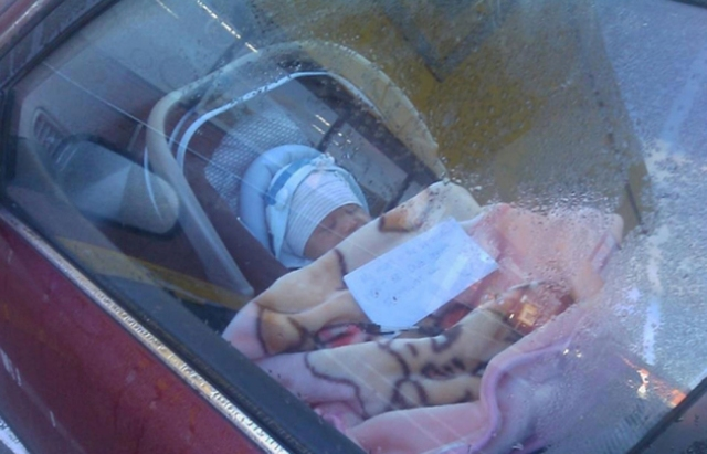 Baby abandoned in a car by mum
