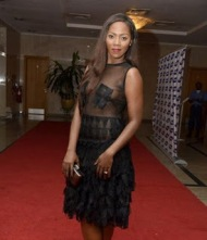 Tiwa Savage in her seethrough dress and funny looking babrbie trousers trying to hide her nipples, but the HD Camera zoomed out some part of it...LOL