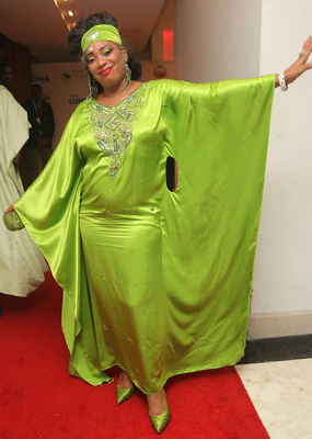 Am sorry. The colour is too bright and the dress is all over the place. This award would've been Rita Dominic but she narrowly escaped with her accessories.