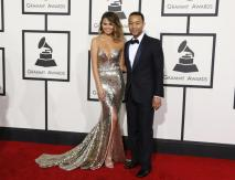 John Legend in Gucci and Chrissy Teigen in Johanna Johnson