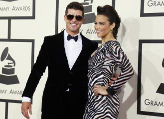 Robin Thicke in Giorgio Armani and wife Paula Patton