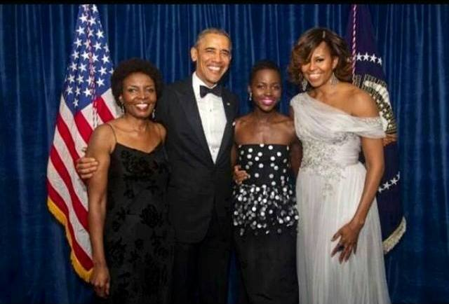 Lupita with the Obamas